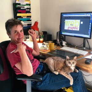 Amanda McCoy sitting in her office with a cat on her lap.